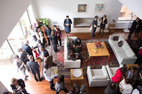 Guests mingle at the new Norwegian ambassador's residence in Bogotá