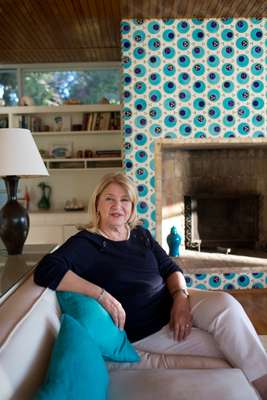 Owner Julide Neslihan Taki in the living room