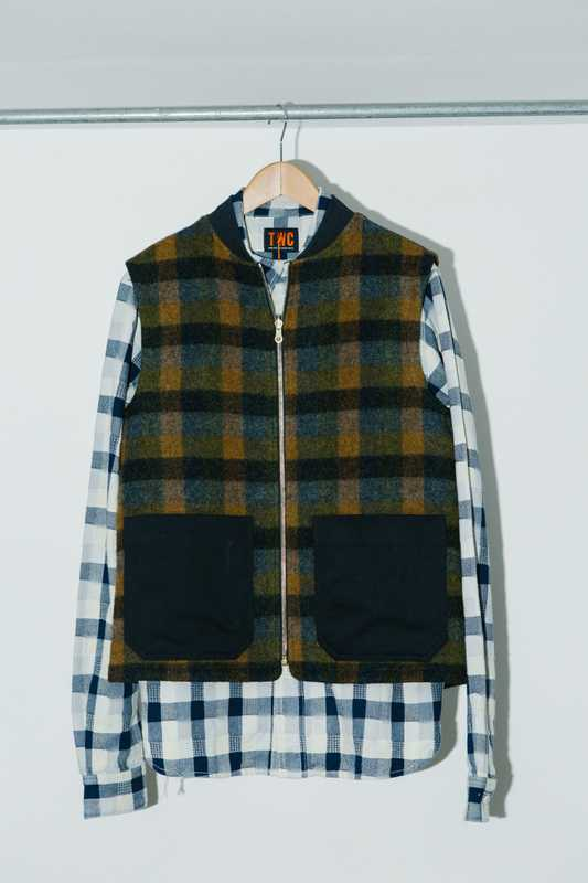Checked-wool gilet over a patchwork shirt