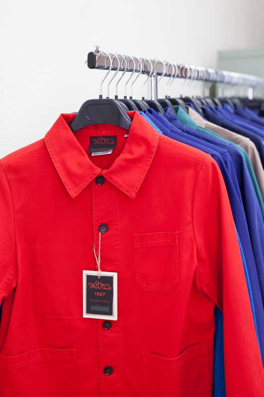Pieces of clothing in bright colours and strong material, historically worn by workers