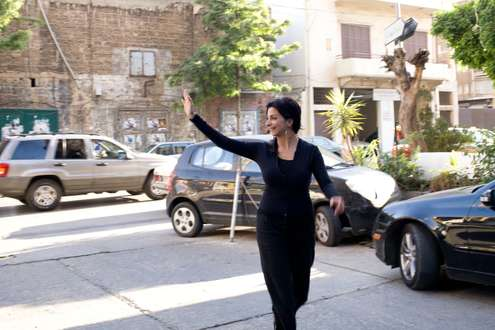 Zeina Daccache waves while walking in Beirut's Mar Mikhayel neighbourhood
