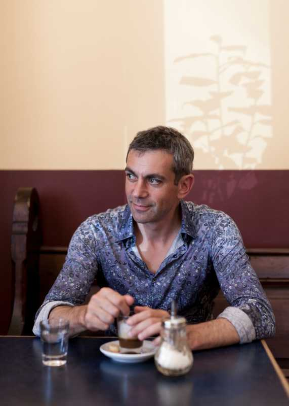 Wladimir Kaminer in Café Meta, near his Berlin apartment