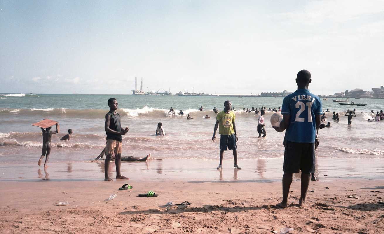 Kids playing football at a beach in Takoradi