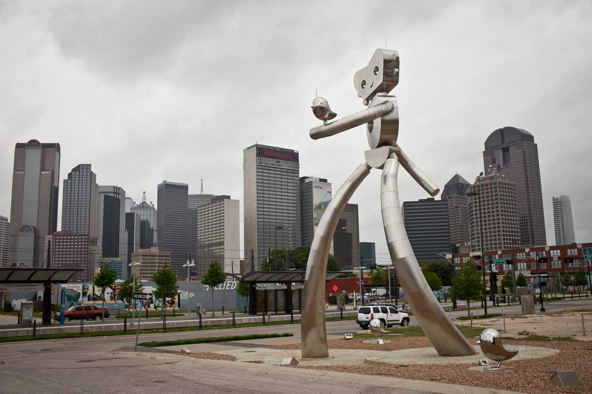 'Traveling Man' at Deep Ellum's DART station, part of Dallas's recent light rail system