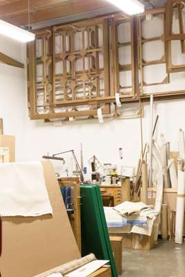 An area of stretching canvas and packing artwork