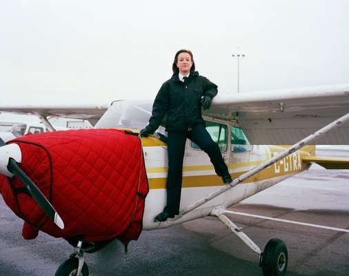 Alexandra Owen, one of Moncton's 15 female students next to a Cessna