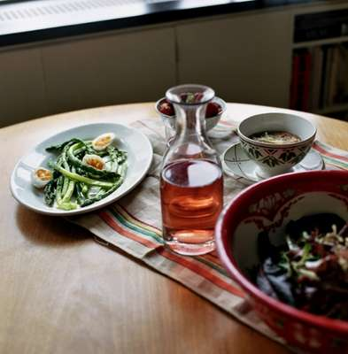 The meal, accompanied by a carafe of rosé
