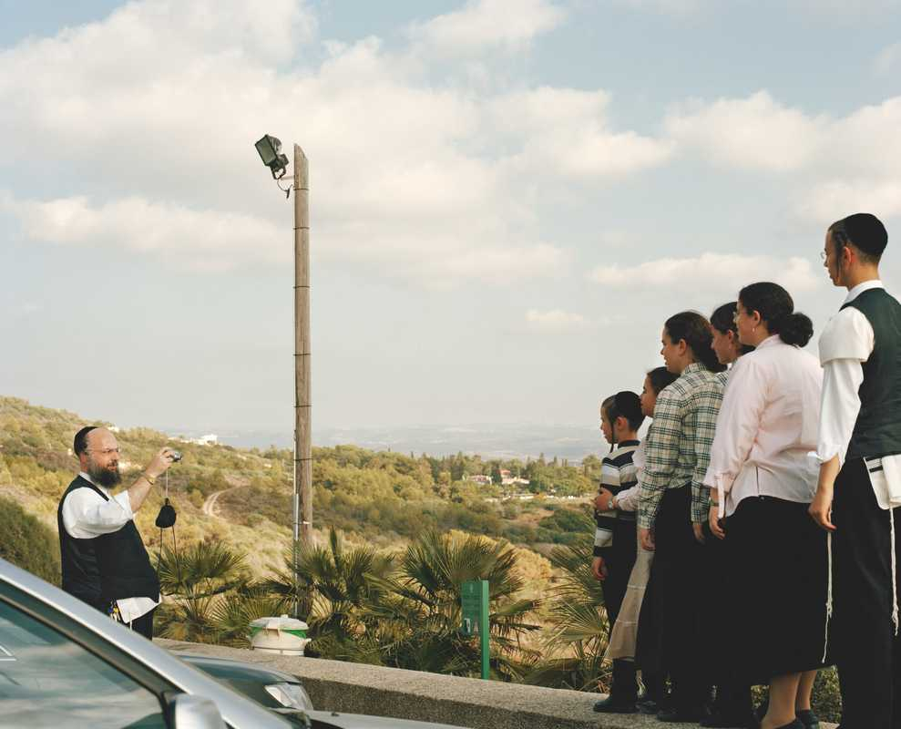A Jewish man photographs his family at the Israel-Lebanon border, Rosh ha-Nikra