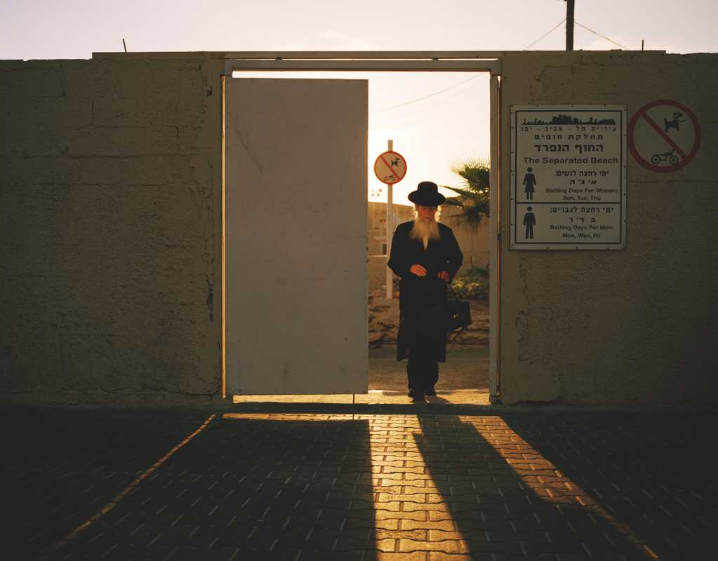 An Orthodox Jew leaves a men-only beach in Tel Aviv