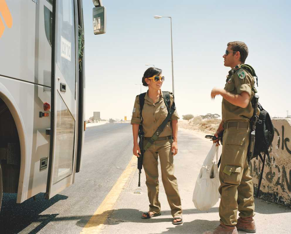 IDF conscripts boarding a bus in Negev desert